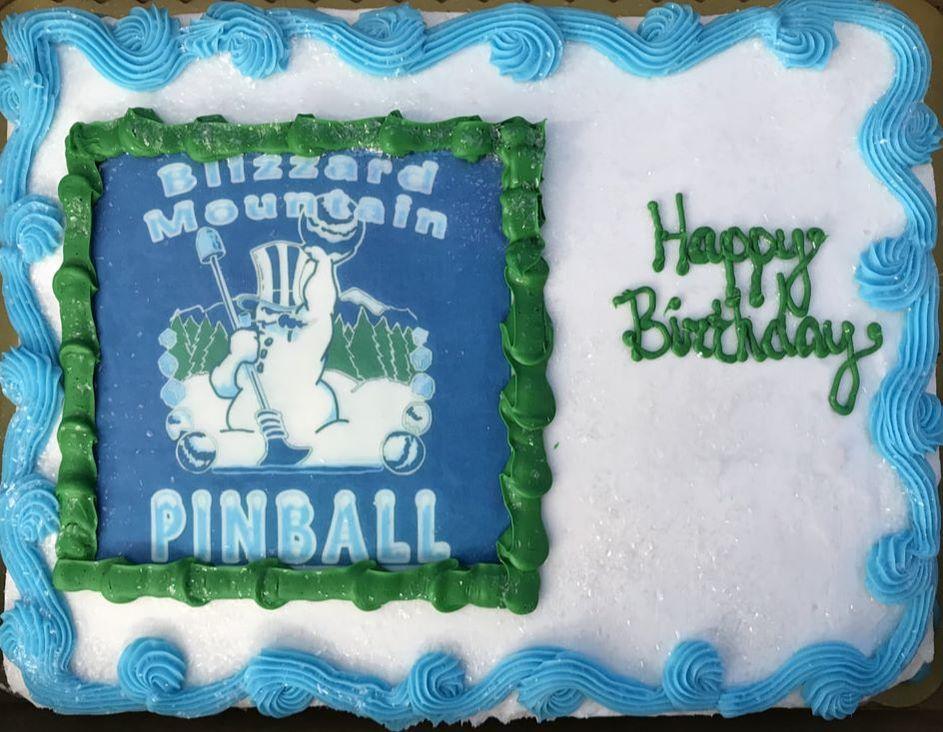 Cake with the Blizzard Mountain Pinball logo