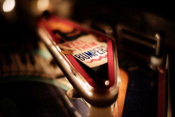 close up of a lit pinball kicker/bumper